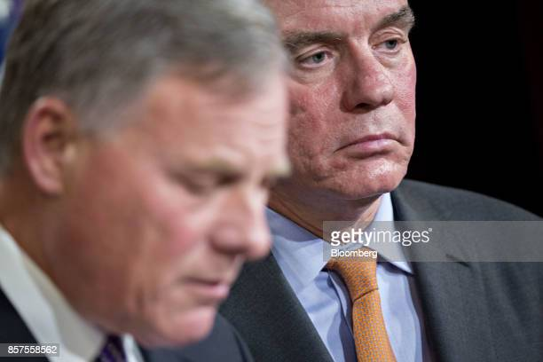 Senator Mark Warner a Democrat from Virginia and ranking member of the Senate Intelligence Committee listens as chairman Senator Richard Burr a...