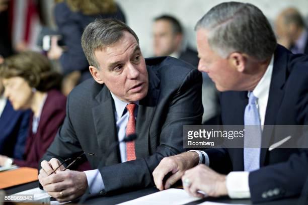 Senator Mark Warner a Democrat from Virginia and ranking member of the Senate Intelligence Committee left speaks with chairman Senator Richard Burr a...