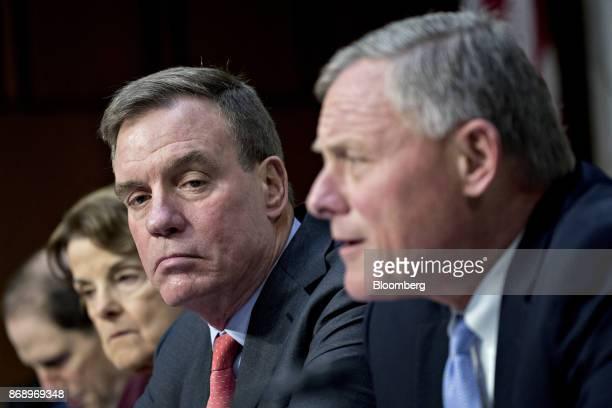 Senator Mark Warner a Democrat from Virginia and ranking member of the Senate Intelligence Committee left listens as chairman Senator Richard Burr a...