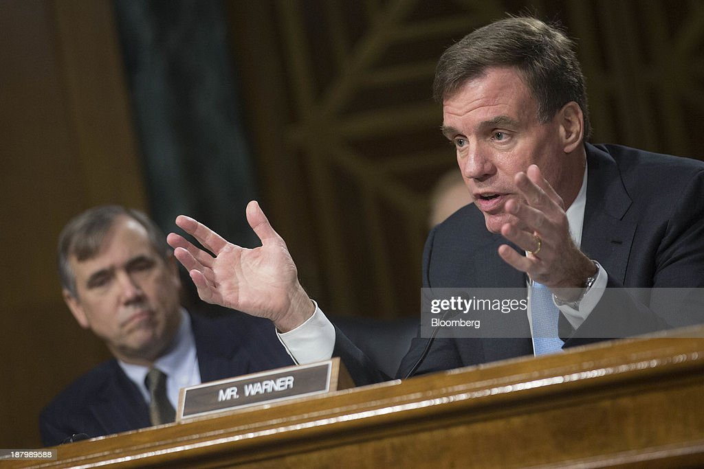 Senator <a gi-track='captionPersonalityLinkClicked' href=/galleries/search?phrase=Mark+Warner&family=editorial&specificpeople=2251151 ng-click='$event.stopPropagation()'>Mark Warner</a>, a Democrat from Virginia, questions Janet Yellen, vice chairman of the U.S. Federal Reserve and U.S. President Barack Obama's nominee as chairman of the Federal Reserve, not pictured, during a Senate Banking Committee confirmation hearing in Washington, D.C., U.S., on Thursday, Nov. 14, 2013. Yellen said she is committed to promoting a strong economic recovery and will ensure monetary stimulus isn't removed too soon. Photographer: Andrew Harrer/Bloomberg via Getty Images