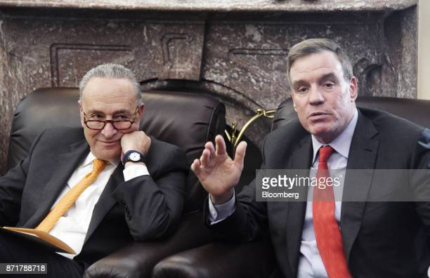 Senator Mark Warner a Democrat from Virginia right speaks as Senate Minority Leader Chuck Schumer a Democrat from New York listens during a meeting...