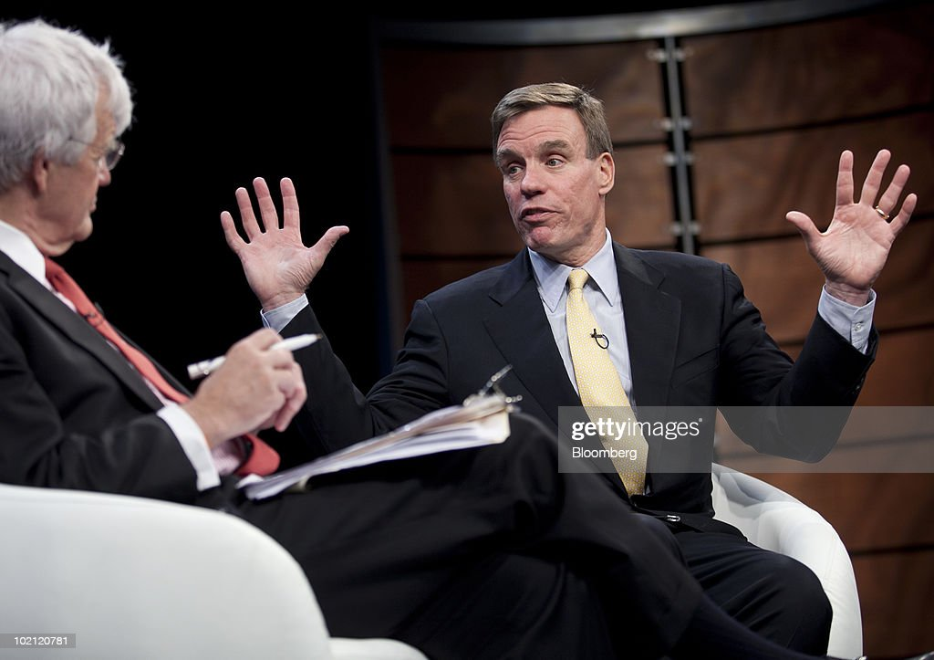 Senator Mark Warner, a Democrat from Virginia, speaks to Albert ÒAlÓ Hunt, executive editor with Bloomberg News, during the Bloomberg Link Boards & Risk Briefing conference in Washington, D.C., U.S., on Tuesday, June 15, 2010. In conjunction with Carnegie Mellon CyLab, the briefing brings together key business, political, and academic leaders to explore critical issues and provoke thoughtful leadership. Photographer: Andrew Harrer/Bloomberg via Getty Images