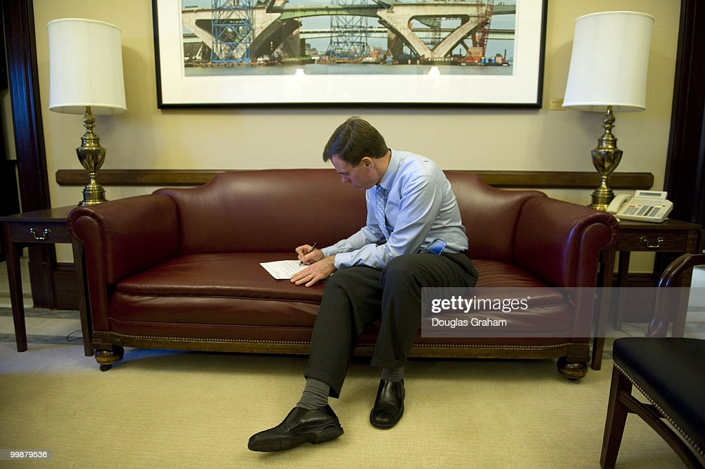 Senator Mark Warner DVA goes over a press release in their office in the Russell Senate Office Building following passage of the health care reform...