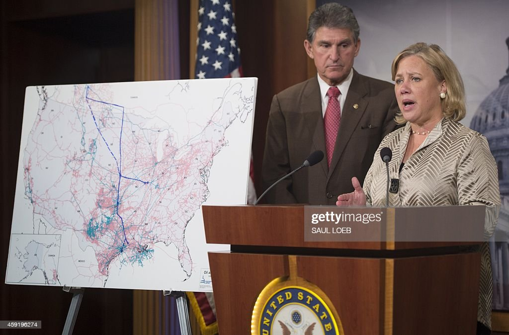 US Senator Mary Landrieu, Democrat of Louisiana, speaks alongside US Senator Joe Manchin, Democrat of West Virginia, during a press conference following a Senate vote on the rejection of the Keystone XL oil pipeline at the US Capitol in Washington, DC, November 18, 2014. The pipeline, which would bring oil from tar sands in Alberta, Canada to refineries on the US Gulf coast, easily passed the Republican-controlled House last week, as it has several times before, but US President Barack Obama has signalled he might veto the bill should it pass the Senate. AFP PHOTO / Saul LOEB