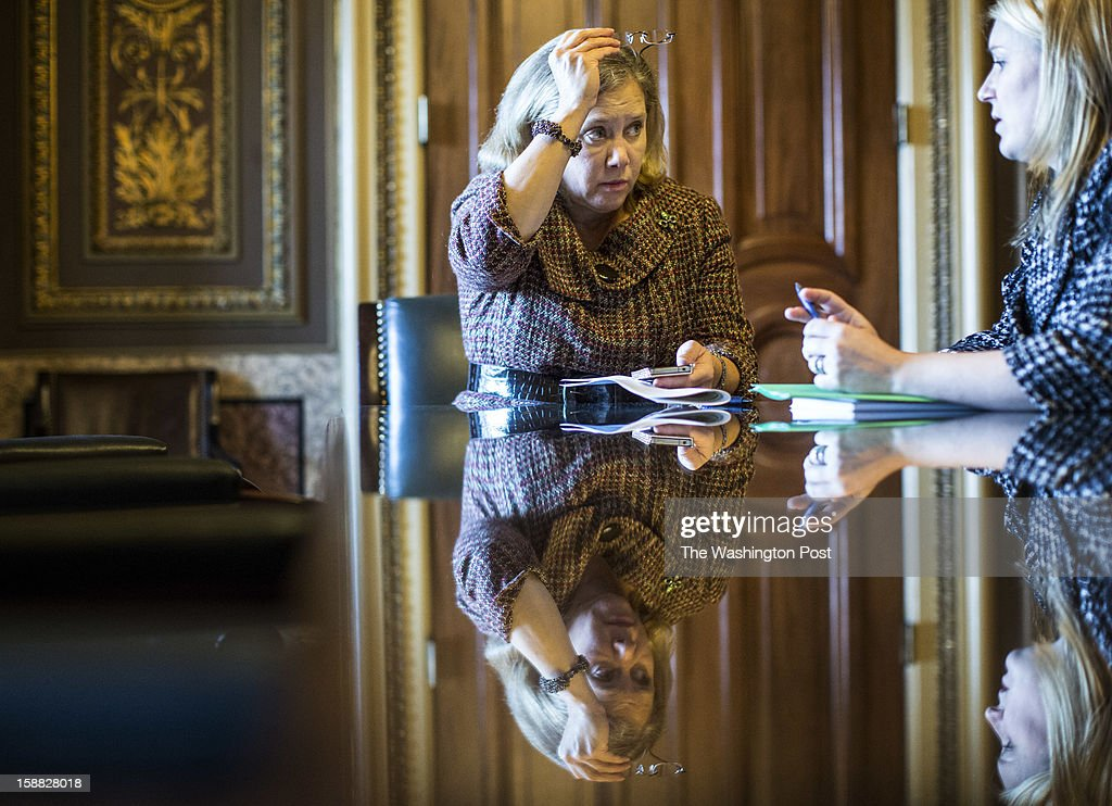 Senator Mary Landrieu (D-LA) works with staff near the Senate floor between votes on a rare Sunday session to consider a possible deal crafted on Saturday behind the scenes to prevent a dive off the 'fiscal cliff', on Capitol Hill, Sunday, December 30, 2012.