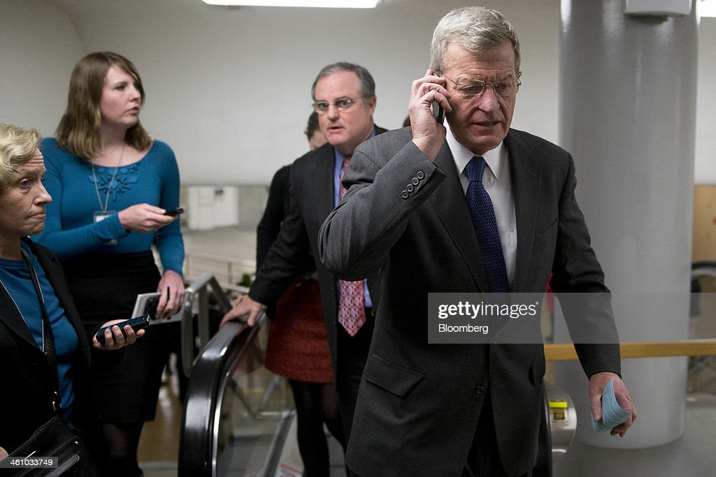 Senator <a gi-track='captionPersonalityLinkClicked' href=/galleries/search?phrase=Max+Baucus&family=editorial&specificpeople=242972 ng-click='$event.stopPropagation()'>Max Baucus</a>, a Democrat from Montana, talks on a mobile phone as he arrives to the U.S. Capitol to vote on the nomination of Janet Yellen as chairman of the U.S. Federal Reserve in Washington, D.C., U.S., on Monday, Jan. 6, 2014. Yellen, currently Fed vice chairman, won U.S. Senate confirmation to become the 15th chairman of the Federal Reserve and the first woman to head the central bank in its 100-year history. Photographer: Andrew Harrer/Bloomberg via Getty Images