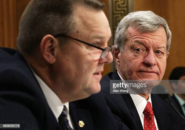 S Senator Max Baucus is introduced by Senator Jon Tester during his confirmation hearing before the Senate Foreign Relations Committee January 28...