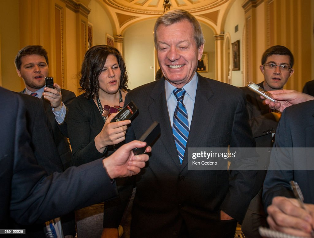 Senator Max Baucus is surrounded by reporters on Capital Hill as deals are worked out to prevent the 'fiscal cliff' from happening December 31 2012...