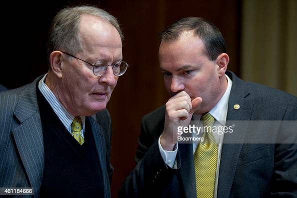 Senator Michael 'Mike' Lee a Republican from Utah right talks to Senator Lamar Alexander a Republican of Tennessee during a Senate Energy and Natural...
