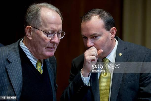 Senator Michael 'Mike' Lee a Republican from Utah right talks to Senator Lamar Alexander a Republican of Tennessee during a Senate Energy and Natural...