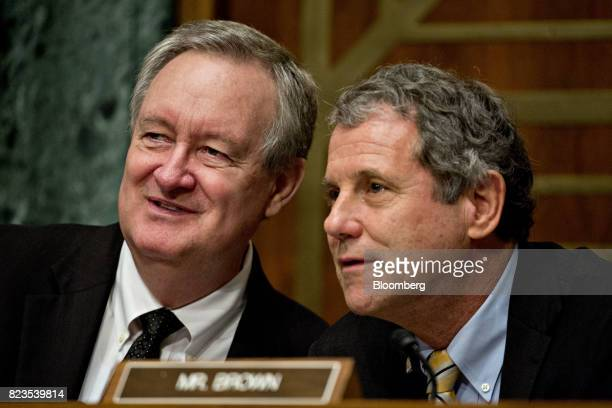 Senator Mike Crapo a Republican from Idaho and chairman of the Senate Banking Committee left speaks with ranking member Senator Sherrod Brown a...