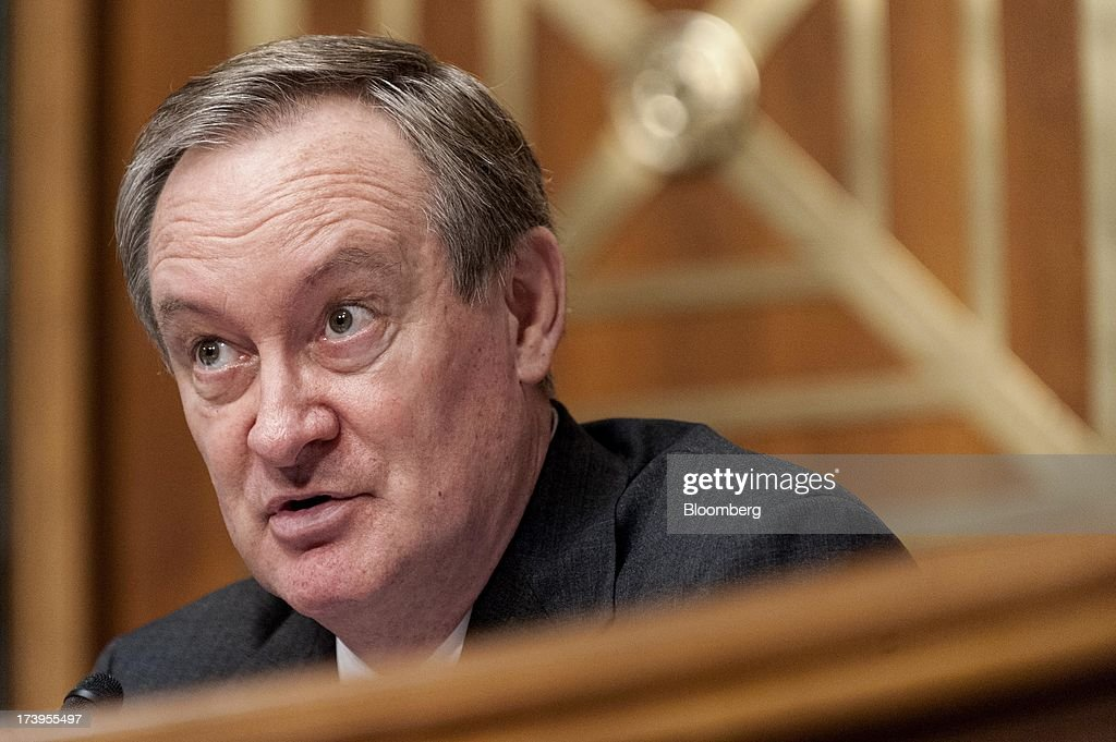 Senator Mike Crapo, a Republican from Idaho, questions Ben S. Bernanke, chairman of the U.S. Federal Reserve, not seen, during his semi-annual monetary policy report to the Senate Banking, Housing, and Urban Affairs Committee in Washington, D.C., U.S., on Thursday, July 18, 2013. Bernanke said one reason for the recent rise in long-term interest rates is the unwinding of leveraged and 'excessively risky' investing. Photographer: Pete Marovich/Bloomberg via Getty Images