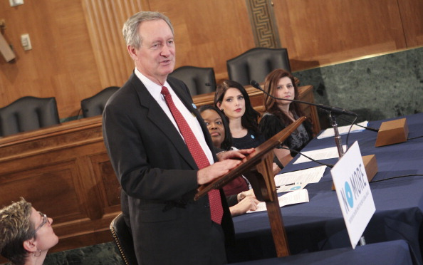 Senator Mike Crapo speaks on Capitol Hill on NO MORE Day with mark Brand Ambassador Ashley Greene and mark President Meg Lerner on March 13 2013 in...