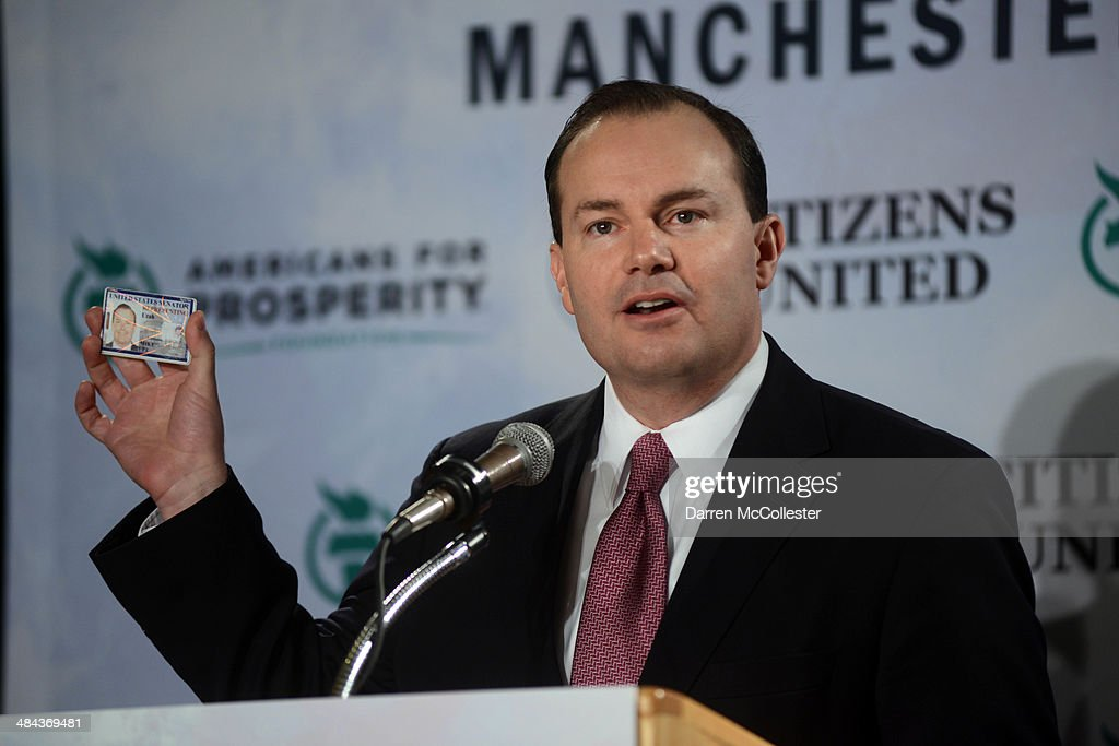 U.S. Senator Mike Lee (R-UT) holds up his senate identification card at the Freedom Summit at The Executive Court Banquet Facility April 12, 2014 in Manchester, New Hampshire. The Freedom Summit held its inaugural event where national conservative leaders bring together grassroots activists on the eve of tax day. Photo by Darren McCollester/Getty Images)