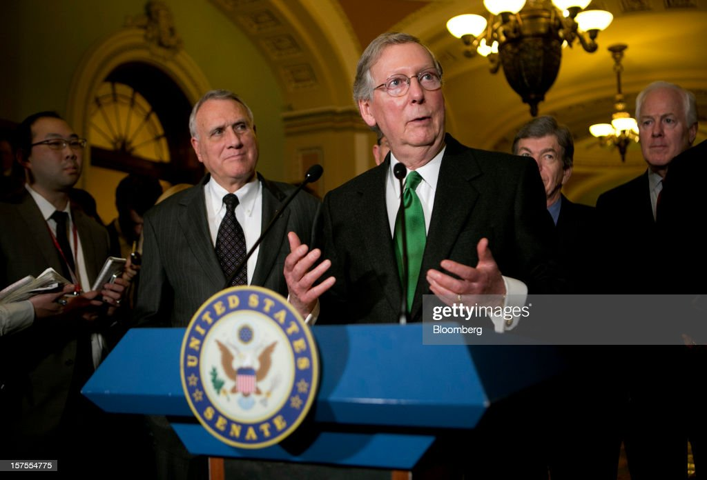 Senator <a gi-track='captionPersonalityLinkClicked' href=/galleries/search?phrase=Mitch+McConnell&family=editorial&specificpeople=217985 ng-click='$event.stopPropagation()'>Mitch McConnell</a>, a Republican from Kentucky, center, speaks during a news conference after the weekly Republican Democratic Policy Committee meeting with Senator John Kyl, a Republican from Arizona, left, at the U.S. Capitol in Washington, D.C., U.S., on Tuesday, Dec. 4, 2012. Negotiations over the so-called fiscal cliff are stalled as President Obama and Republicans trade offers on ways to avoid more than $600 billion in U.S. spending cuts and tax increases for 2013 that will start to take effect in January if Congress doesn't act. Photographer: Andrew Harrer/Bloomberg via Getty Images