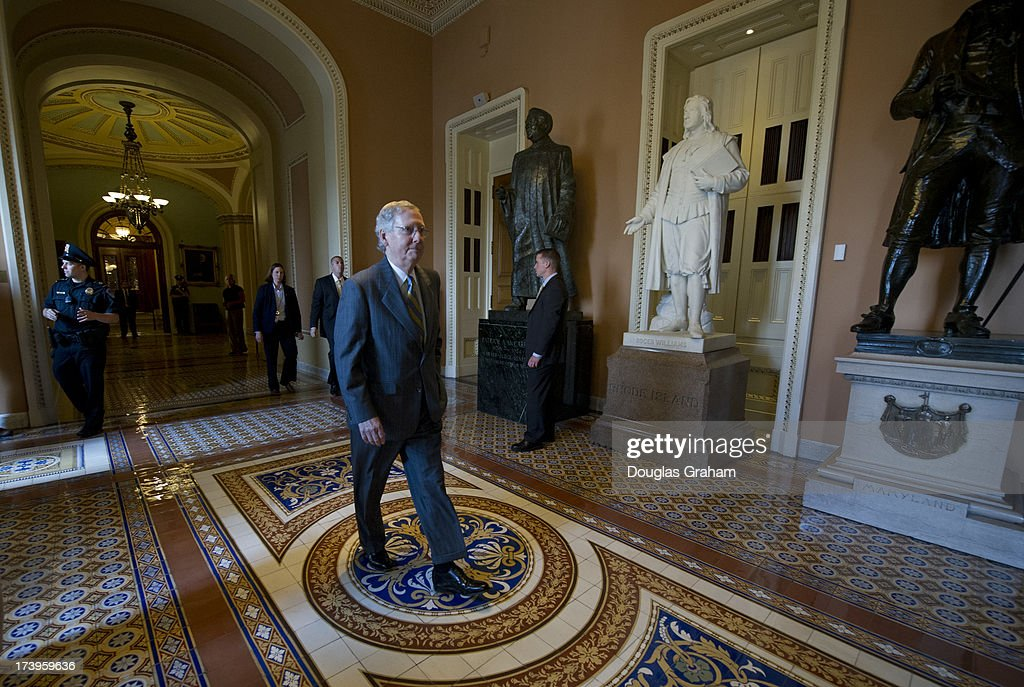 U.S. Senator Mitch McConnell, R-KY., walks though the U.S. Capitol on July 18, 2013.