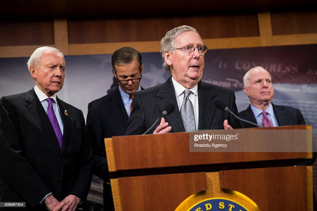 Senator Mitch McConnell speaks during a press conference on the Internet Tax Ban and Customs Report as Senators (L-R) Orrin Hatch, John Thune, and John McCain stand behind him in Washington, USA on February 11, 2016.