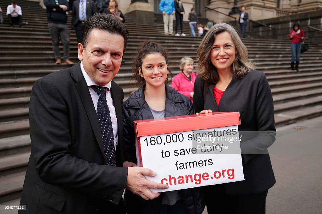 Senator <a gi-track='captionPersonalityLinkClicked' href=/galleries/search?phrase=Nick+Xenophon&family=editorial&specificpeople=7398766 ng-click='$event.stopPropagation()'>Nick Xenophon</a> shows his support on the steps of Parliament House on May 25, 2016 in Melbourne, Australia. The Federal Government is expected to announce an assistance package for dairy farmers, who have been struggling due to falling milk prices in recent months.