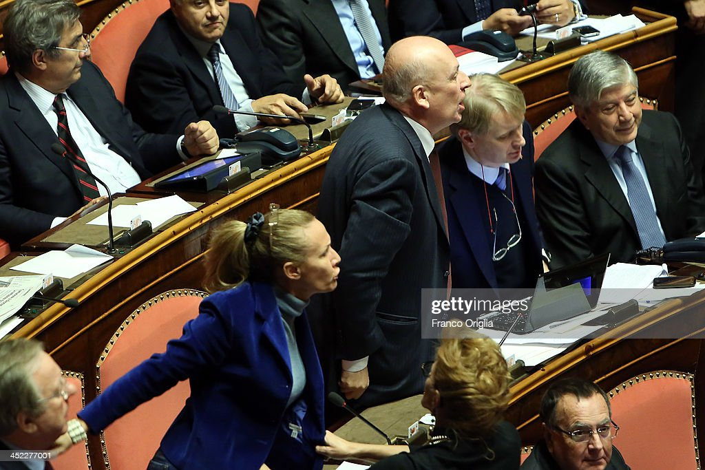 Senator of the PDL Party (center-right), and former Culture's minister <a gi-track='captionPersonalityLinkClicked' href=/galleries/search?phrase=Sandro+Bondi&family=editorial&specificpeople=693804 ng-click='$event.stopPropagation()'>Sandro Bondi</a> (C) protest for the votes procedure over Silvio Berlusconi's Parliament expulsion at the Italian Senate, Palazzo Madama on November 27, 2013 in Rome, Italy. The Italian Senate has today voted to expel former Prime Minister Silvio Berlsuconi from parliament after his recent conviction over tax fraud.