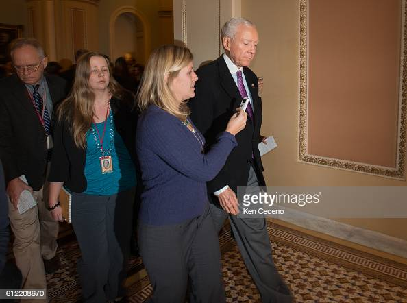 Senator Orin Hatch is surrounded by reporters on Capitol Hill December 31 2012 in Washington DC while Congressional Leaders try to work out a deal to...