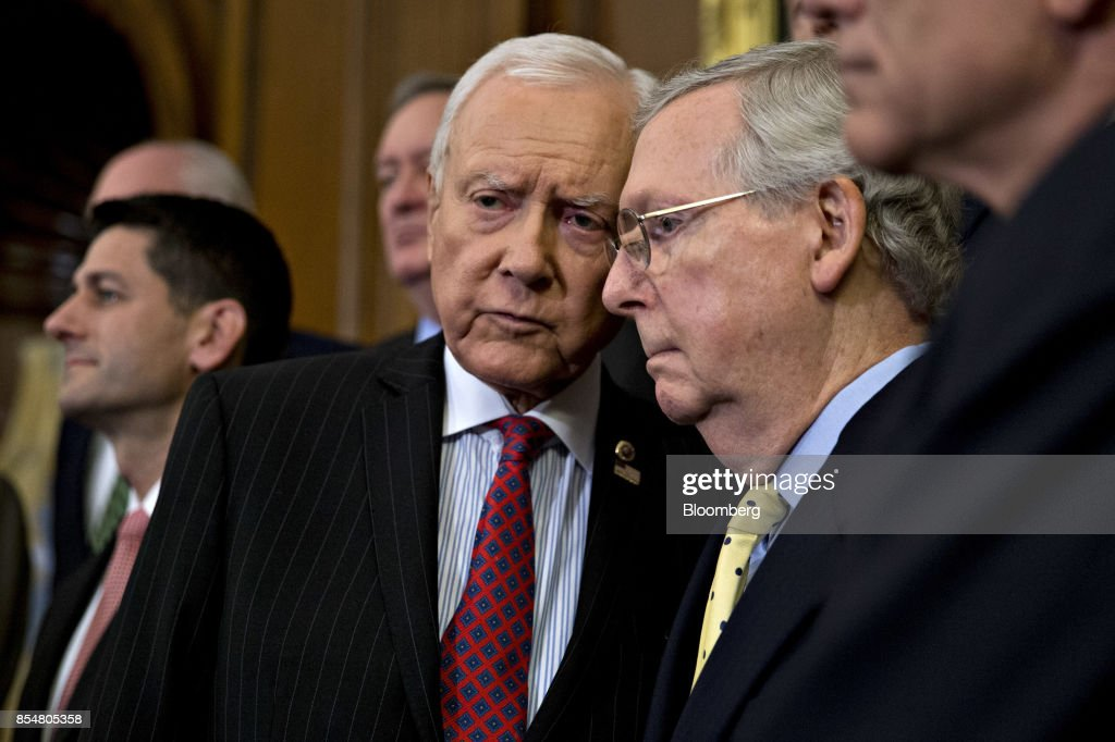 Senator Orrin Hatch, a Republican from Utah and chairman of the Senate Finance Committee, center, talks to Senate Majority Leader Mitch McConnell, a Republican from Kentucky, during a news conference on a unified tax reform framework at the U.S. Capitol in Washington, D.C., U.S., on Wednesday, Sept. 27, 2017. President Donald Trump and congressional leaders are rolling out a framework for a tax overhaul that would condense the existing seven tax rates to three, and cut the top rate to 35 percent from 39.6 percent. Photographer: Andrew Harrer/Bloomberg via Getty Images