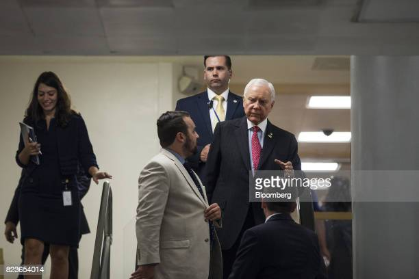 Senator Orrin Hatch a Republican from Utah right speaks to members of the media near the Senate Subway in Washington DC US on Thursday July 27 2017...