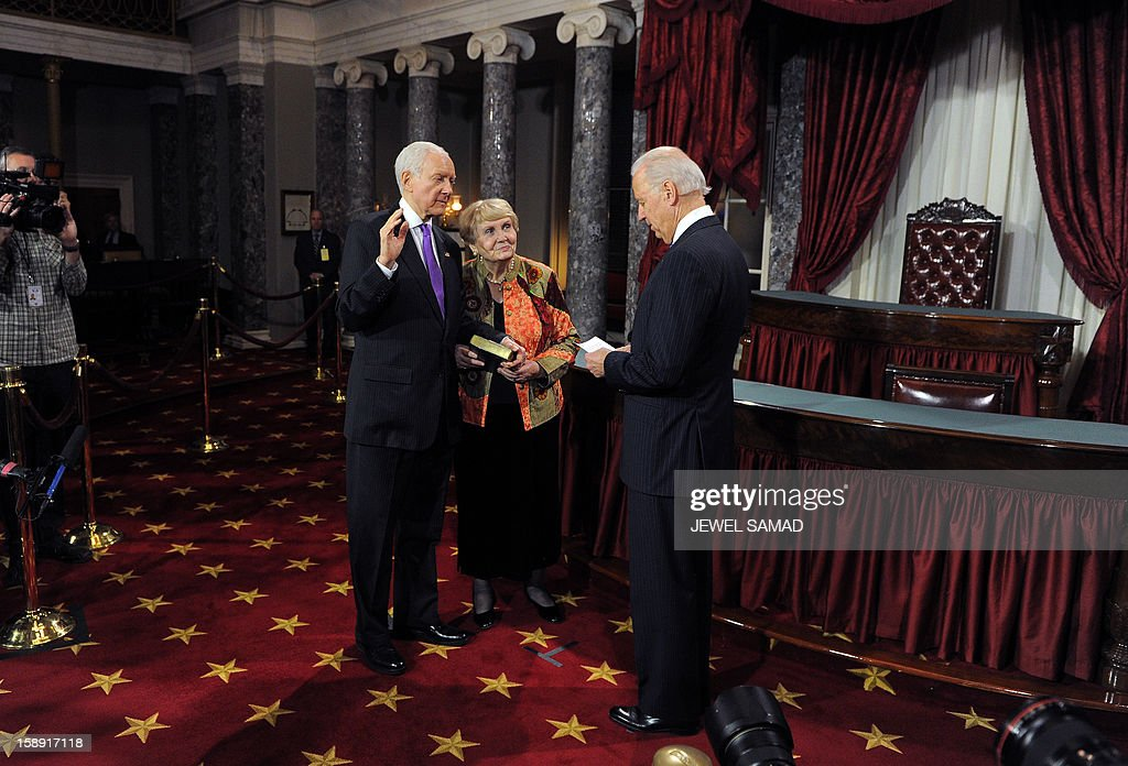 US Senator Orrin Hatch, R-UT, (L) participates in a reenacted swearing-in with US Vice President Joe Biden in the Old Senate Chamber at the U.S. Capitol January 3, 2013 in Washington, DC. The 113th US Congress, featuring dozens of new faces in the House and Senate, convened Thursday fresh from the year-end 'fiscal cliff' fiasco, as lawmakers cast a wary eye towards the tough budget battles ahead. AFP PHOTO/Jewel Samad