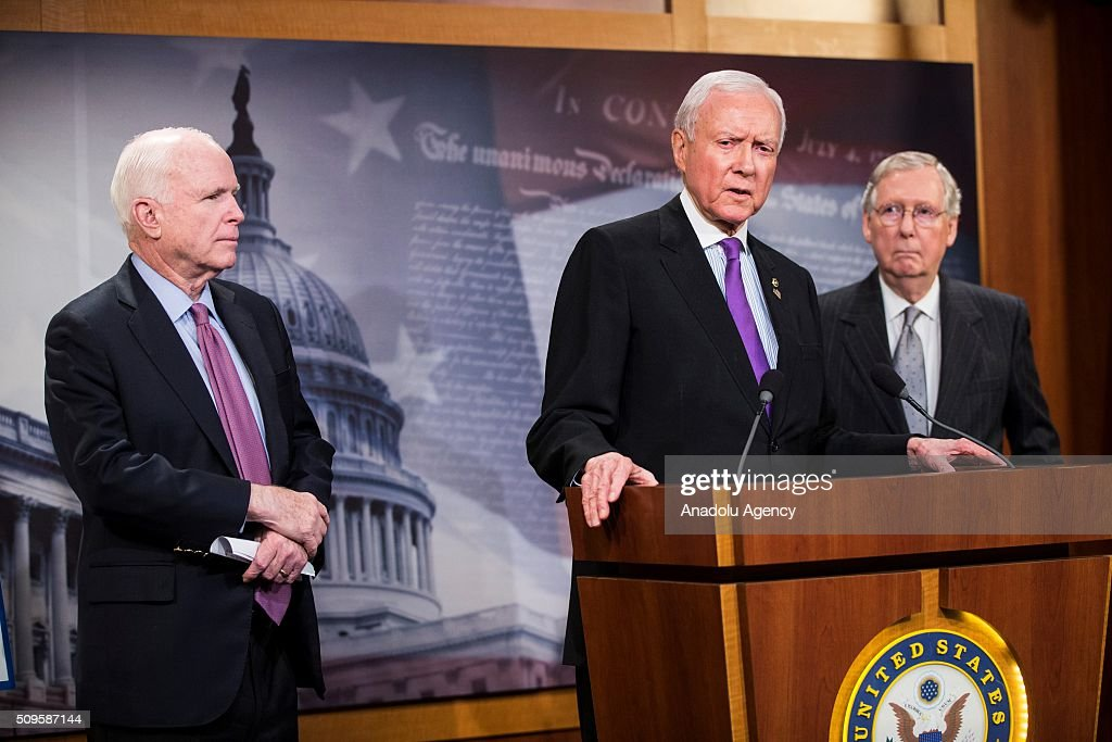 Senator Orrin Hatch speaks during a press conference on the Internet Tax Ban and Customs Report as Senators John McCain (L) and Mitch McConnell (R) stand near him in Washington, USA on February 11, 2016.
