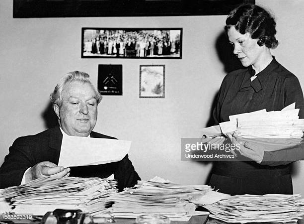 Senator Pat McCarran of Nevada and his assistant Hazel Smith sort through the avalanche of letters supporting his action of inserting the prevailing...
