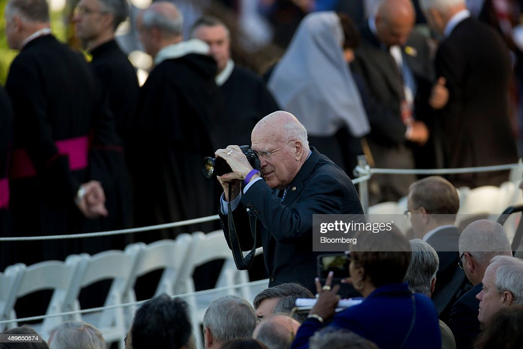Senator Patrick Leahy, a Democrat from Vermont, takes a photograph before the start of an arrival ceremony for Pope Francis, not pictured, on the South Lawn of the White House in Washington, D.C., U.S., on Wednesday, Sept. 23, 2015. Pope Francis opened his six-day U.S. tour on Tuesday, bringing a call for Americans to do more to fight poverty, curb climate change and help immigrants. His visit runs through Sept. 27, and features stops in Washington, New York and Philadelphia. Photographer: Andrew Harrer/Bloomberg via Getty Images
