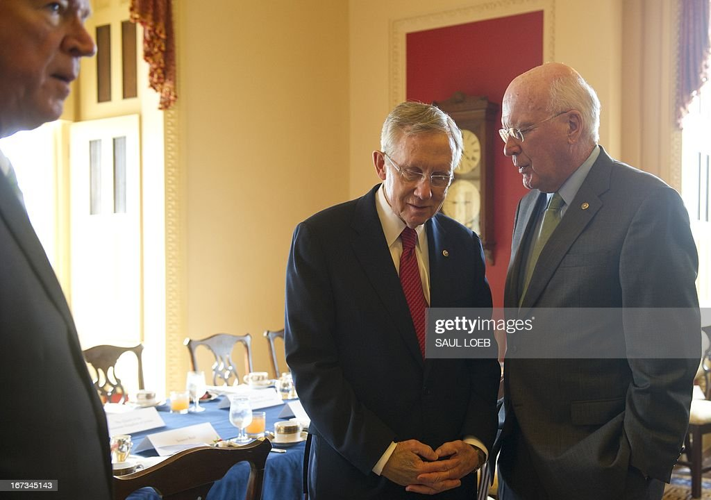 US Senator Patrick Leahy (R), Democrat of Vermont, and US Senate Majority Leader Harry Reid (L) speak prior to meetings with King Abdullah II of Jordan at the US Capitol in Washington, DC, on April 24, 2013. AFP PHOTO / Saul LOEB