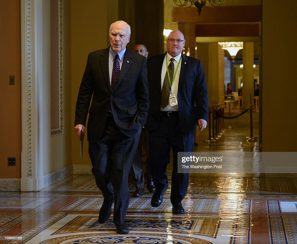 Senator Patrick Leahy(D-VT) walks through a hallway near the Senate chamber where US lawmakers at the Capitol wrangle over negotiations to head off the fiscal cliff on December, 31, 2012 in Washington, DC.
