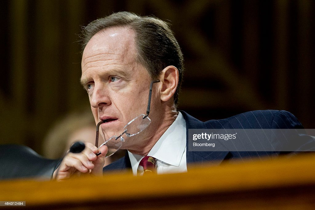 Senator Patrick 'Pat' Toomey, a Republican from Pennsylvania, listens during a Senate Banking Committee hearing with Janet Yellen, chair of the U.S. Federal Reserve, not pictured, in Washington, D.C., U.S., on Tuesday, Feb. 24, 2015. Yellen said inflation and wage growth remain too low even as the job market improves, and she signaled that a change in the Fed's guidance on interest rates won't lock it into a timetable for tightening. Photographer: Andrew Harrer/Bloomberg via Getty Images