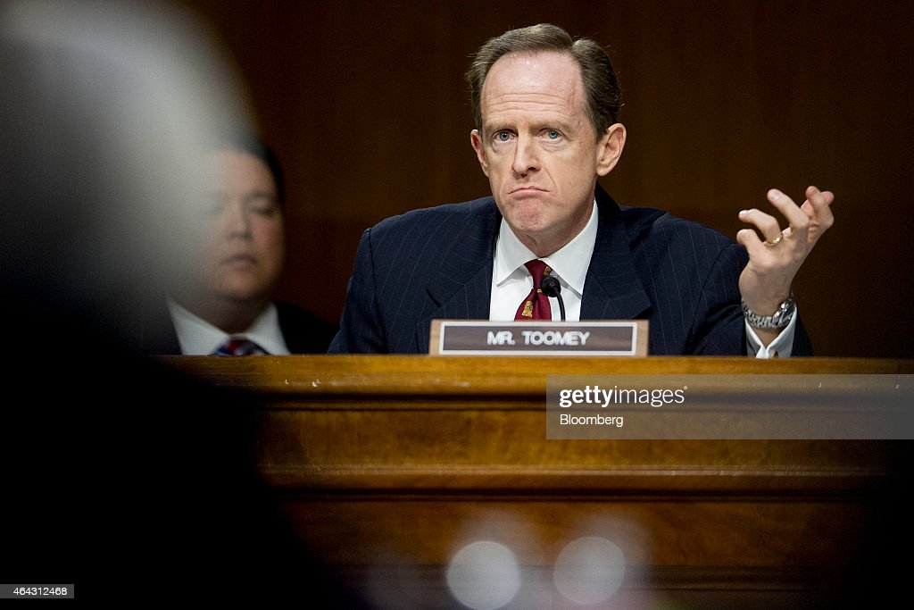 Senator Patrick 'Pat' Toomey, a Republican from Pennsylvania, questions Janet Yellen, chair of the U.S. Federal Reserve, left, during a Senate Banking Committee hearing with Janet Yellen, chair of the U.S. Federal Reserve, not pictured, in Washington, D.C., U.S., on Tuesday, Feb. 24, 2015. Yellen said inflation and wage growth remain too low even as the job market improves, and she signaled that a change in the Fed's guidance on interest rates won't lock it into a timetable for tightening. Photographer: Andrew Harrer/Bloomberg via Getty Images