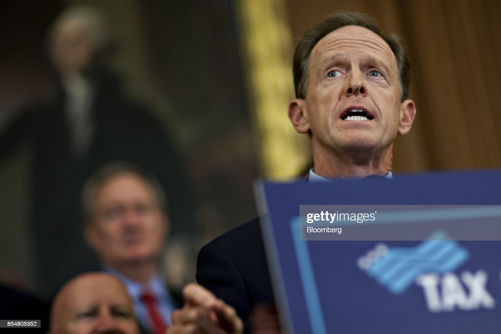 Senator Patrick Toomey, a Republican from Pennsylvania, speaks during a news conference on a unified tax reform framework at the U.S. Capitol in Washington, D.C., U.S., on Wednesday, Sept. 27, 2017. President Donald Trump and congressional leaders are rolling out a framework for a tax overhaul that would condense the existing seven tax rates to three, and cut the top rate to 35 percent from 39.6 percent. Photographer: Andrew Harrer/Bloomberg via Getty Images