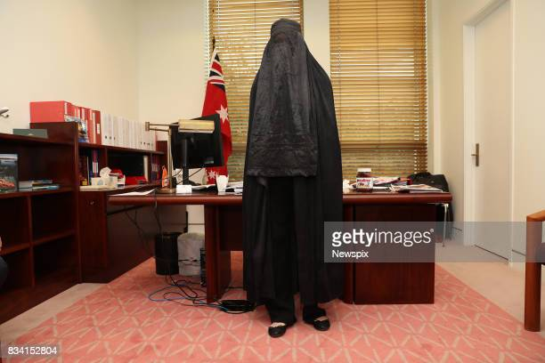 CANBERRA ACT Senator Pauline Hanson puts on a burqa ahead of her appearance in Parliament in Canberra Australian Capital Territory