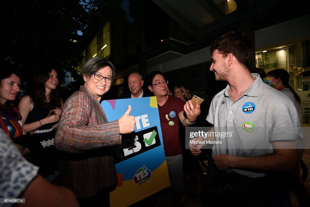 Senator Penny Wong celebrates with crowds gathering on Lonsdale Street in Canberra to celebrate the results of the same-sex marriage survey on November 15, 2017 in Canberra, Australia. Australians have voted for marriage laws to be changed to allow same-sex marriage, with the Yes vote claiming 61.6% to to 38.4% for No vote. Despite the Yes victory, the outcome of Australian Marriage Law Postal Survey is not binding, and the process to change current laws will move to the Australian Parliament in Canberra.