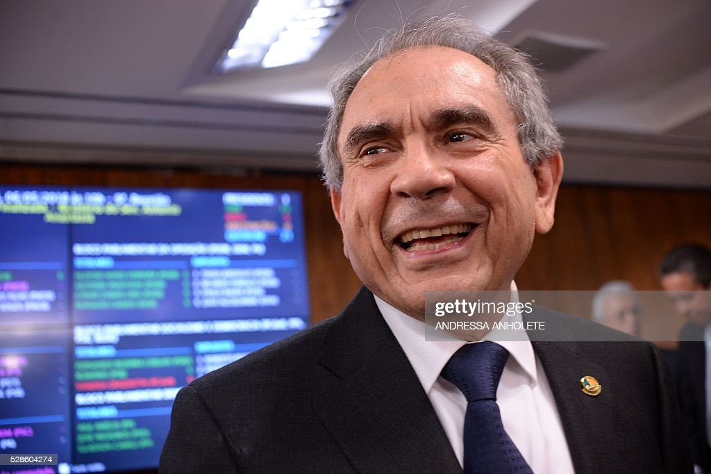 Senator Raimundo Lira, President of the Senate's Impeachment Special Committee against President Dilma Rousseff, poses in front of the result panel at the end of a voting session at the National Congress in Brasilia on May 6, 2016. A special committee in Brazil's Senate voted Friday to approve starting an impeachment trial against President Dilma Rousseff, who now faces being suspended from office in less than a week. The committee's recommendation was non-binding but marked the last formal stage before the full Senate votes Wednesday on whether to put the leftist leader on trial. Rousseff is accused of illegally manipulating government budget accounts. / AFP / ANDRESSA