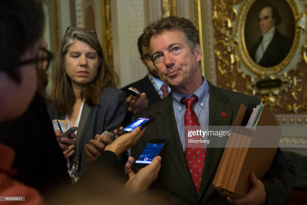 Senator <a gi-track='captionPersonalityLinkClicked' href=/galleries/search?phrase=Rand+Paul&family=editorial&specificpeople=6939188 ng-click='$event.stopPropagation()'>Rand Paul</a>, a Republican from Kentucky, talks to reporters before walking into the Senate Chamber in Washington, D.C., U.S., on Friday, Sept. 27, 2013. The U.S. Senate voted to finance the government through Nov. 15 after removing language to choke off funding for the health care law, putting pressure on the House to avoid a federal shutdown set to start Oct. 1. Photographer: Andrew Harrer/Bloomberg via Getty Images