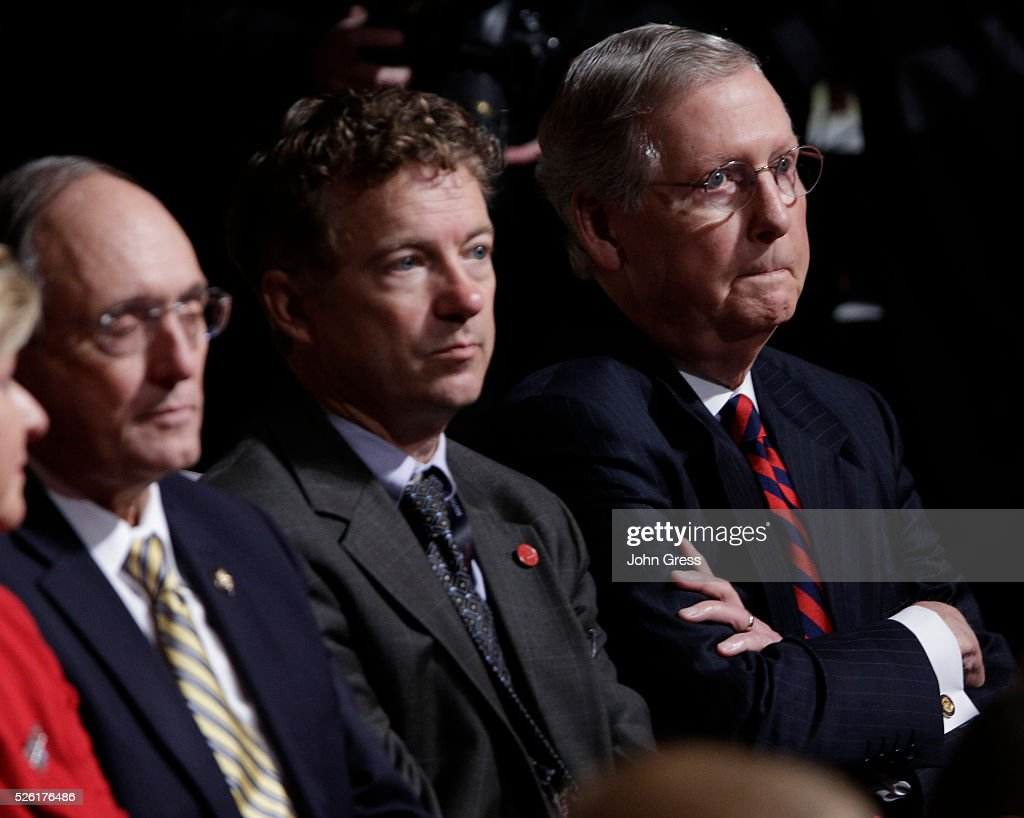 US Senator Rand Paul and US Senate Minority Leader Mitch McConnell listen to US Vice President Joe Biden and Republican vice presidential nominee...