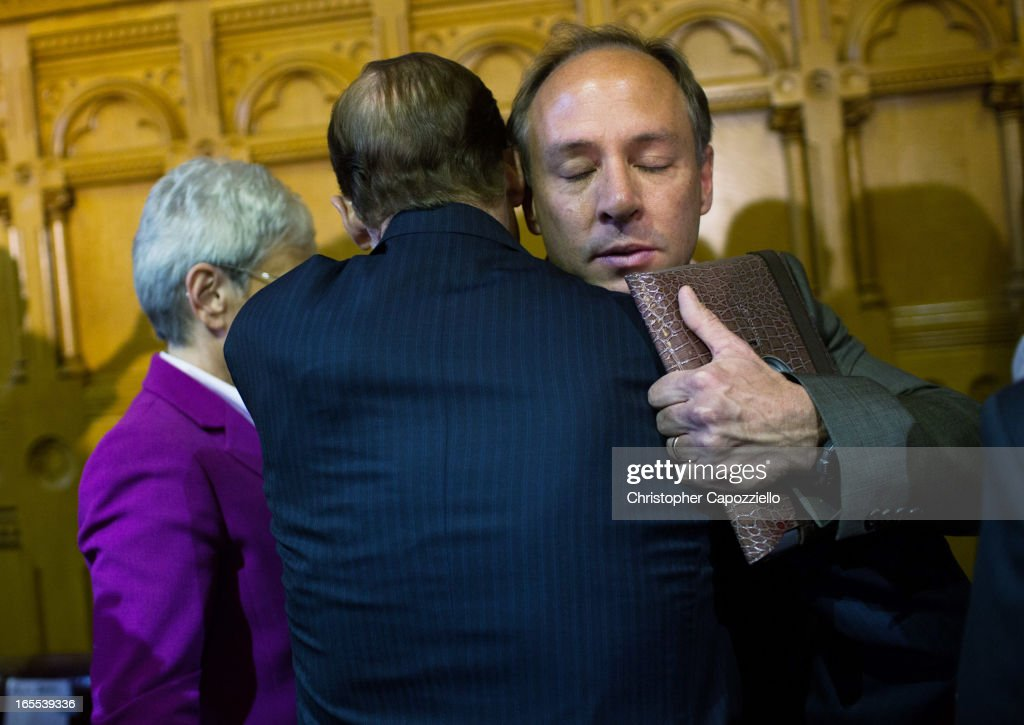 U.S. Senator <a gi-track='captionPersonalityLinkClicked' href=/galleries/search?phrase=Richard+Blumenthal&family=editorial&specificpeople=1036916 ng-click='$event.stopPropagation()'>Richard Blumenthal</a> (L) (D-CT) hugs hugs Mark Barden, the parent of a Sandy Hook shooting victim, after the signing of a gun control law at the Connecticut Capitol pril 4, 2013 in Hartford, Connecticut, After more than 13 hours of debate, the Connecticut General Assembly approved the gun-control bill early April 4, that proponents see as the toughest-in-the-nation response to the Demember 14, 2012 Newtown school shootings.