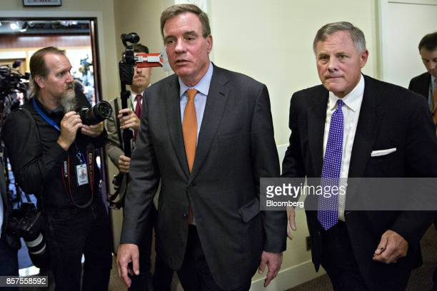 Senator Richard Burr a Republican from North Carolina and chairman of the Senate Intelligence Committee right and ranking member Senator Mark Warner...