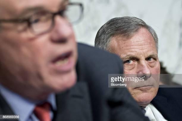 Senator Richard Burr a Republican from North Carolina and chairman of the Senate Intelligence Committee right listens as ranking member Senator Mark...