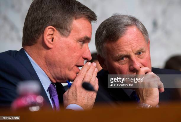 US Senator Richard Burr Republican of North Carolina and Chairman of the Senate Select Committee on Intelligence speaks with US Senator Mark Warner...
