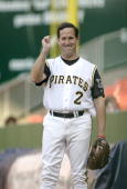 S Senator Rick Santorum gestures as he warms up at the 44th Annual Congressional Baseball Game on June 23 2005 at RFK Stadium in Washington DC The...