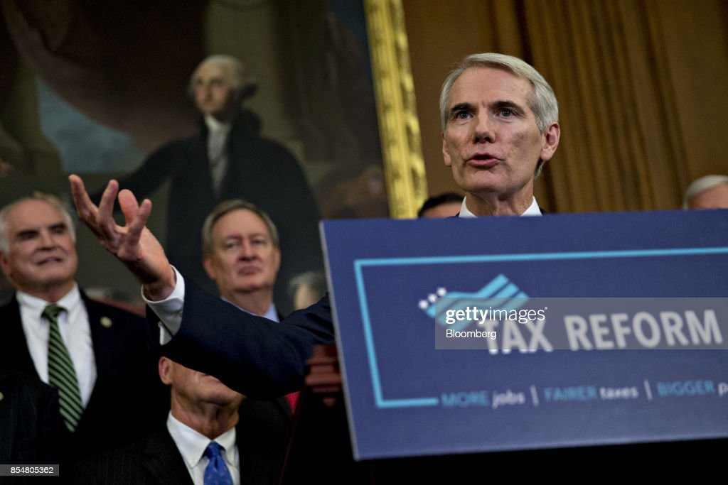 Senator Rob Portman, a Republican from Ohio, speaks during a news conference on a unified tax reform framework at the U.S. Capitol in Washington, D.C., U.S., on Wednesday, Sept. 27, 2017. President Donald Trump and congressional leaders are rolling out a framework for a tax overhaul that would condense the existing seven tax rates to three, and cut the top rate to 35 percent from 39.6 percent. Photographer: Andrew Harrer/Bloomberg via Getty Images