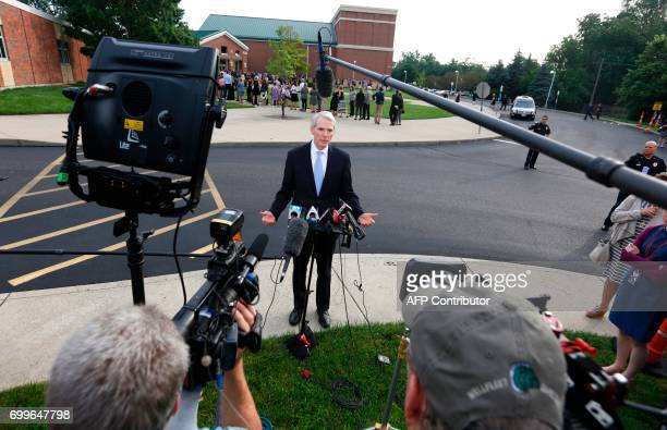 US Senator Rob Portman speaks to reporters outside Wyoming High School in Wyoming Ohio on June 22 before the funeral for Otto Warmbier Warmbier an...