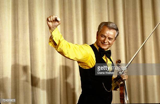 Senator Robert Byrd giving a clenched fist acknowledgement after playing fiddle for friends colleagues at the Democratic Committee Gala Dinner