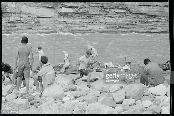 Senator Robert Kennedy jumps for shore as his raft comes to a landing during a four day trip along the Colorado River The New York Senator and a...