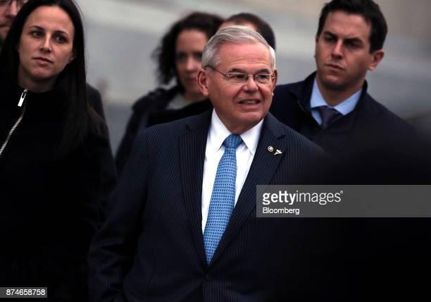 Senator Robert Menendez a Democrat from New Jersey center exits federal court in Newark New Jersey US on Wednesday Nov 15 2017 Jurors at the bribery...